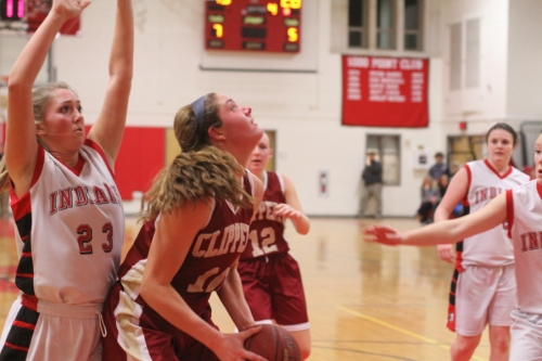 McKenzie Cloutier (12 points) readies a block attempt against Emily Pettigrew (13 points)