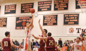 Robbie Glavin (16 points) launches a jump shot