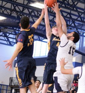 Jonathan Rodriguez (#35), EJ Perry (#4), and Andy Henriquez (#15) battle for a rebound