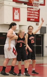 Beverly tries to keep the ball away from 1000-point scorer Jackie Panneton