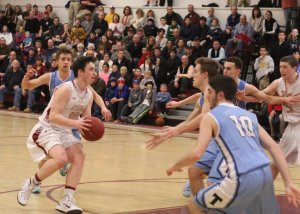 Dan Baribeault sees plenty of Triton defenders on the last possession