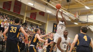 Isaiah McLeod soars above the Andover defense getting sixteen points in the first quarter