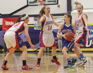 Kelly Arsenault hemmed in by a trio of Lancers