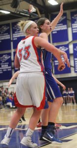 Tara Burke crowds Meg Knollmeyer (11 points)