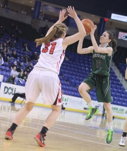 Kelsi McNamara puts up a runner in the lane