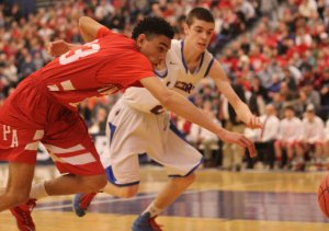 Geo Baker and Jake Coleman chase a loose ball