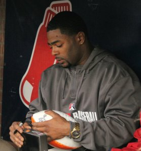 Malcolm signs a football
