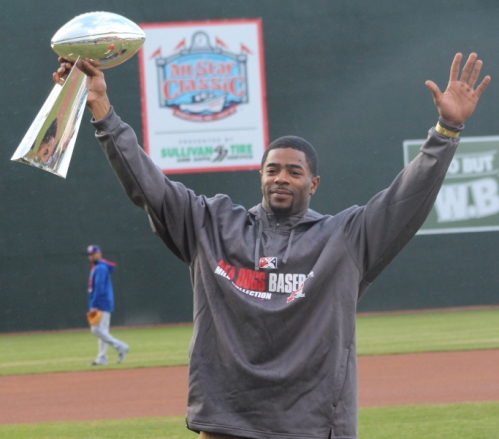 Super Bowl hero Malcolm Butler salutes the crowd at Hadlock Field with the SB trophy