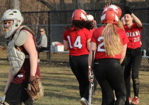 Emily Robinson (#14) gets mobbed by her Amesbury teammates after 3-run homer