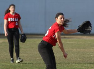 Maddie Napoli (shortstop) throws to first