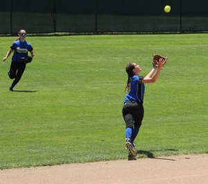 Shortstop Emily Perley attempts a running catch