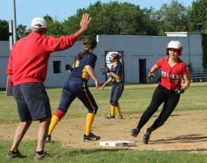 AHS coach Chris Perry puts the stop on baserunner Hayley Catania