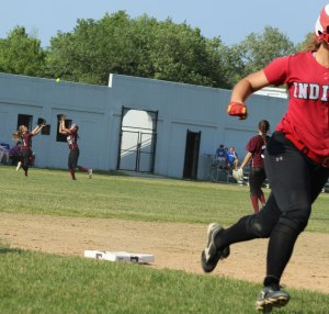 CF Rachel Haselgard about to save a run with a terrific catch