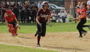 Catcher Caity Baker comes out after a bunt