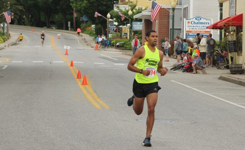 Winner Andrew Stewart leads the way past the Bridgton News office with second-place Silas Eastman in the distance