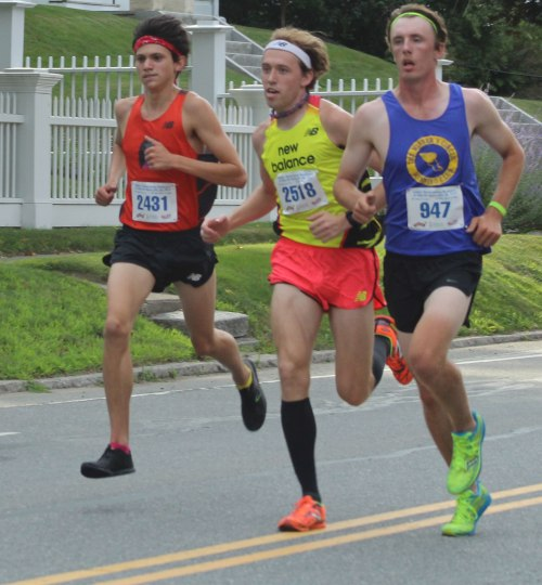 Nick Carleo, Pat Fullerton, and Jacob Johns close together one mile into the YK 5K