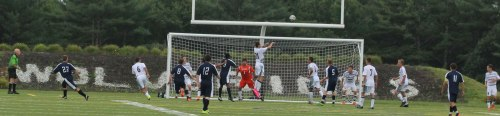 Justin D'Orlando (21) skies to clear corner kick