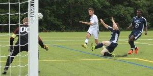 Jack Kingdon fires a shot (wide)
