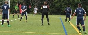 Seawolves defense as Noah Medeiros kicks a corner kick