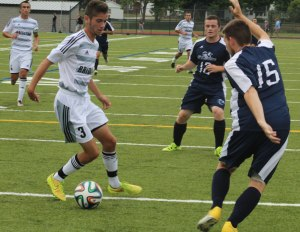 Justin Kingdon puts a move on Jacob Coffey