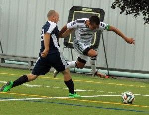 Noah Medeiros leaps to get by SMCC defender Jacob Cavacas