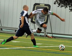 Noah Medeiros leaps to get by SMCC defender Jacob Cavacas