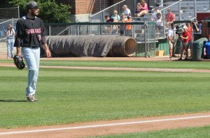 Harrison Musgrave eyes the home plate umpire