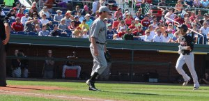 Will Swanner home run trots past pitcher Mike McCarthy