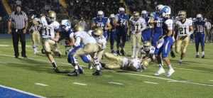 Jared Pearson carries tacklers to the end zone