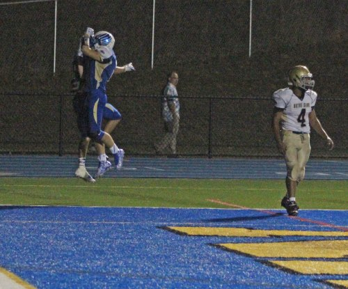 Plenty of end zone celebrating for Newtown as they crossed the goal line six times against Notre Dame - Fairfield