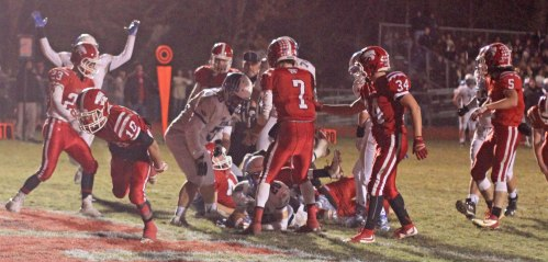 Mike Doyle (on the ground with the ball) reaches the end zone in the first half