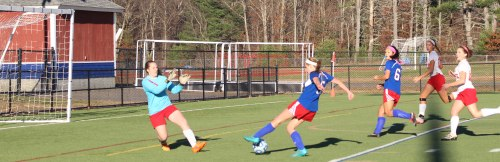 Laurel Goding & Erin Barnes in close on GK Sam Mitchell