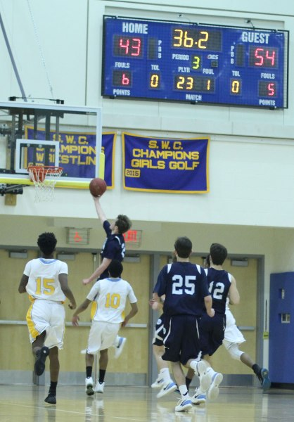Jack Williams (21 points) gets two during Wilton's second-half, seventeen-point run.