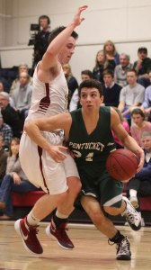 Nate McGrail (21 points) drives to the basket