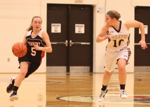 Kelly Scipione drives on Katie King