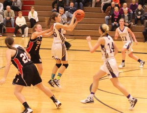 Claire Olmstead (#15) intercepts a Panthers' pass