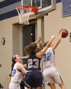 Alex Kennedy (32) blocks