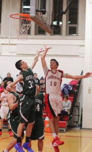 Spencer Pacy (13 points) contests Riley O'Connor's layup attempt