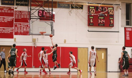 Jimmy Cleary gets a backdoor layup after a pass from Conor O'Neil (#11)