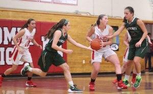Lily Polakiewicz draws two defenders