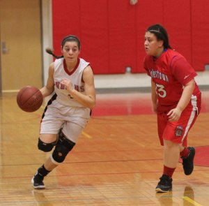 Maddie Napoli (11 points) gets past Keila Derosa