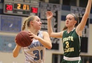 Erin Savage guarded by Julia McDonald