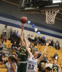 Jess Lezon gets a layup over Abby Ostrander