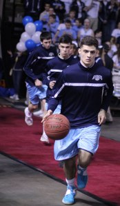 Keenan Hendricks leads the Mariners onto the court