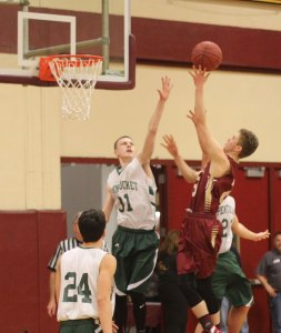 Robbie Shay shoots over Spencer Pacy