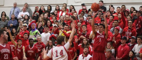 Dan Bertrand (12 points) shoots from in front of the Saugus bench and crowd