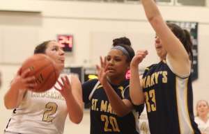 Fredi DeGuglielmo (14 points) defended by Kayla Carter and Katie Dixon