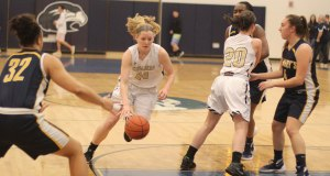 Colleen Corcoran uses an Ellen Fantozzi screen to drive to the basket