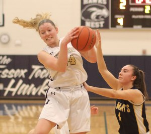 Colleen Corcoran gets one of her eleven rebounds