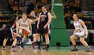 Marissa Gattuso faces two defenders